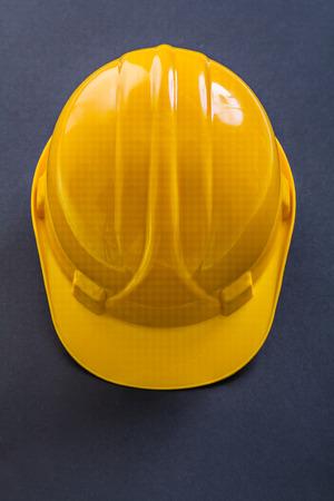 yellow helmet: yellow helmet on black background