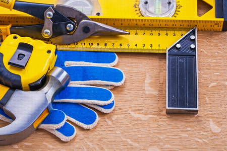 t square: Brown wood board with collection of construction tools Stock Photo