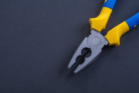 close up view: pliers on black background close up view