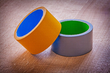 Rolls of duct tape on vintage brown wood board Stock Photo - 40133609