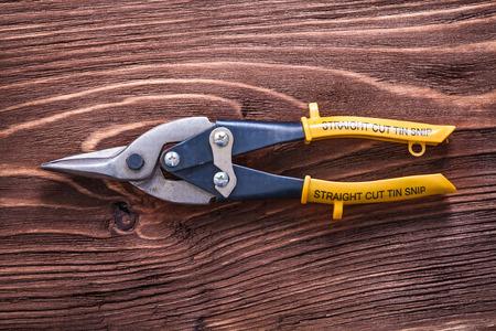 metal cutting: Single metal cutting pliers on wood vintage board