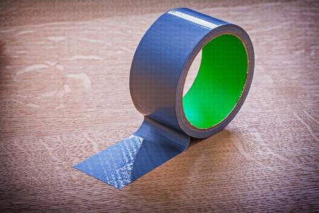 unwound: Unwound duct tape on vintage wooden board