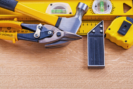 t square: Variation of construction tools on wooden background