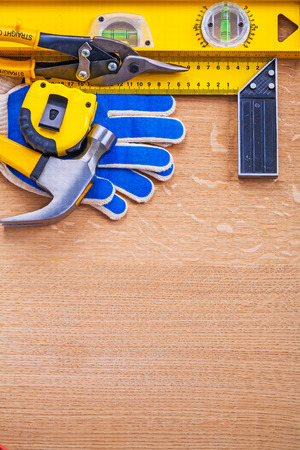 t square: Variation of construction tools on wooden brown board Stock Photo
