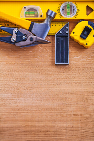 t square: Variation of working tools on wooden background
