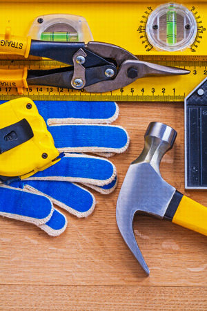 t square: Vintage wooden board with collection of repairing objects Stock Photo
