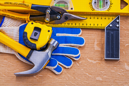 t square: Vintage wood board with variation of construction tools