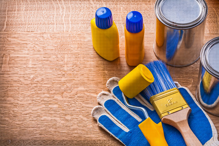 maintenance: Wooden board with house improvement paint tools