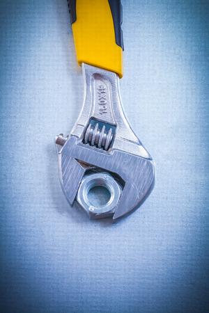 screw key: Adjustable key and metal screw nut on metallic background constr Stock Photo