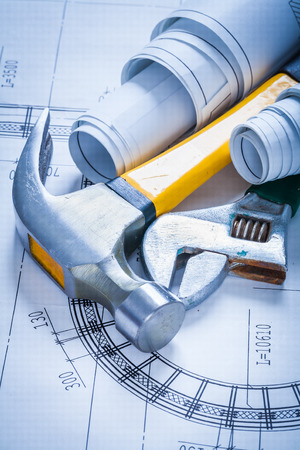 claw hammer: Adjustable spanner rolled up blueprints and claw hammer maintena