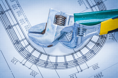 concep: Adjustable spanners on construction blueprint maintenance concep