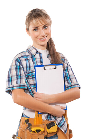 toolbelt: beautiful female worker with toolbelt holding clipboard blank sh
