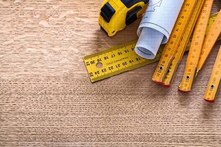 oaken: Blueprints and instruments of measurement on oaken wooden board