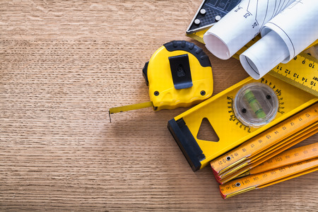 construction level: Blueprints wooden meter measuring tape construction level and sq Stock Photo