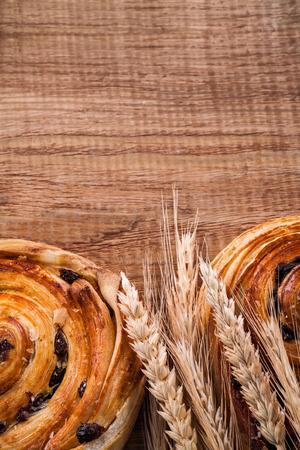 oaken: Bunch of wheat ears raisin bakery on oaken wooden board food and