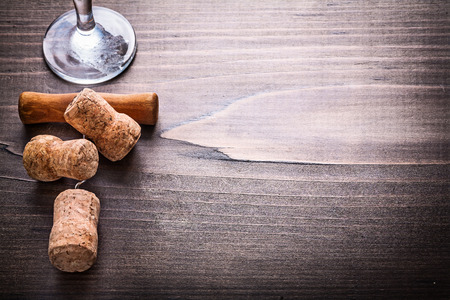 big cork: champagne corks with corkscrew on vintage wooden board organi Stock Photo