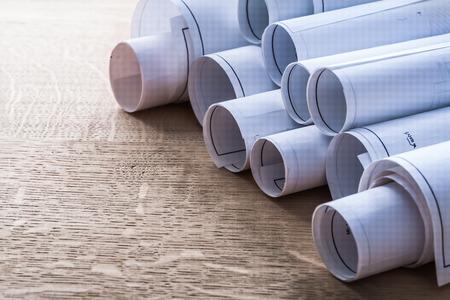 oaken: Collection of blueprint rolls on wooden oaken board construction