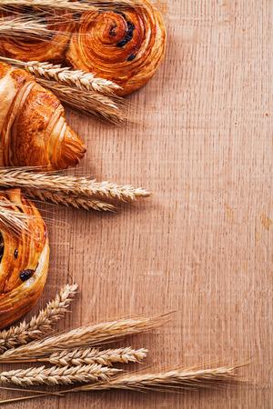 oaken: Composition of wheat ears bakery goods on oaken wooden board foo Stock Photo