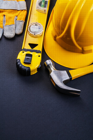 tape line: composition of yellow working tools claw hammer tape line constr Stock Photo