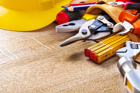 tool belt: construction tools in tool belt and on wooden board