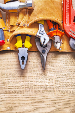 toolbelt: construction tools in toolbelt nippers pliers cutter hammer on w Stock Photo