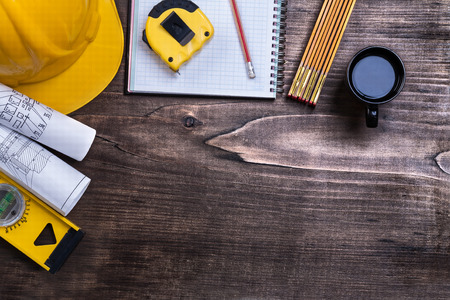 copybook: Copybook pencil cup of coffee and construction objects on pine w