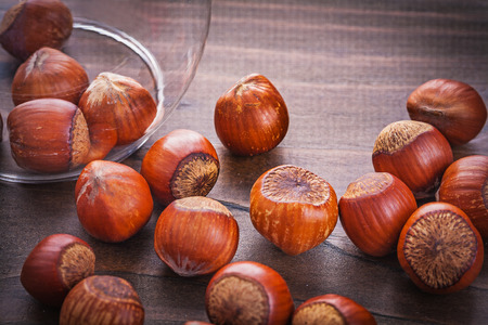 poured: hazelnuts poured on vintage wooden board Stock Photo