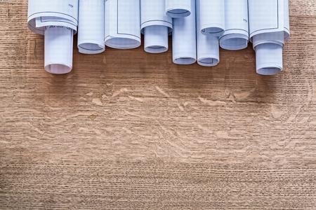 oaken: Heap of construction plans on wooden oaken board maintenance con Stock Photo