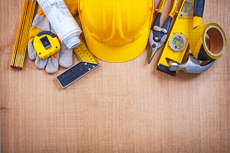 House improvement tools on oak wooden board construction concept Standard-Bild
