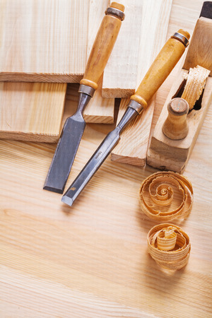 scobs: joinery chisels and woodworkers plane with shawings on wooden bo