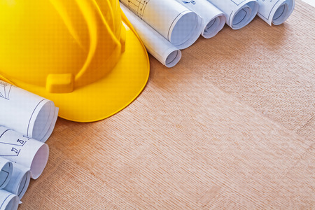 oaken: Oaken wooden board with building helmet and construction plans r Stock Photo