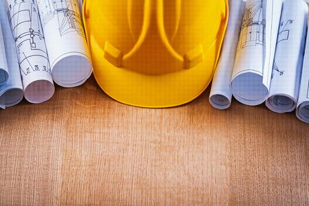 oaken: Oaken wooden board with building helmet and heap of construction