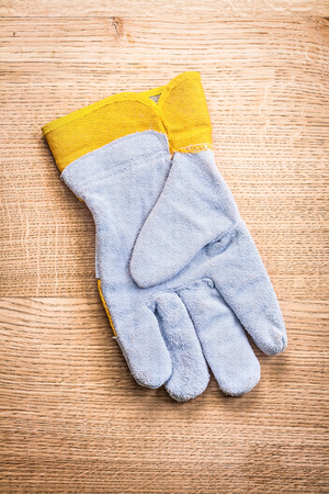 obverse: obverse side of the protective glove on wooden board