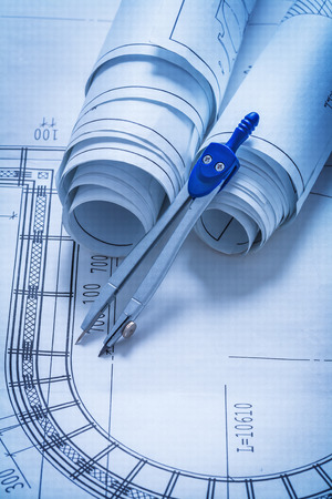compas de dibujo: Rollos de planos y dibujo construcci�n comp�s concepto