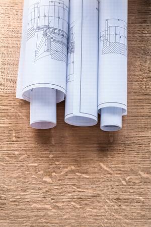 oaken: Rolls of construction drawings on wooden oaken board maintenance