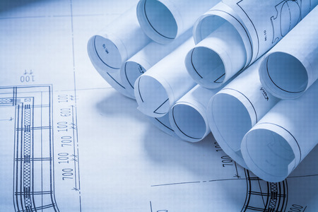Stack of construction plans building and architecture concept