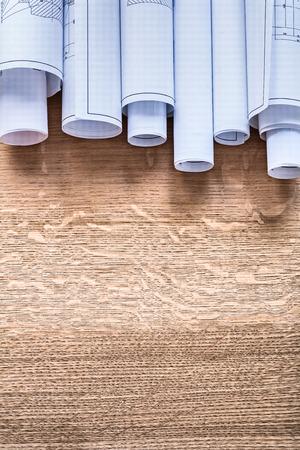 oaken: Stack of construction plans on wooden oaken board maintenance co