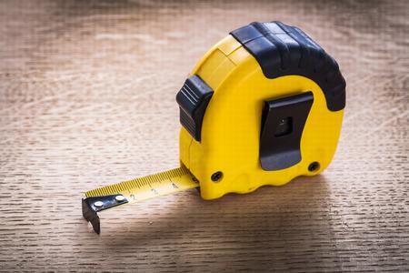 oaken: Tape measure on oaken wooden board maintenance concept Stock Photo