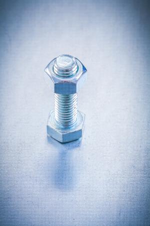 threaded: Threaded screw bolt with construction nut on metallic background