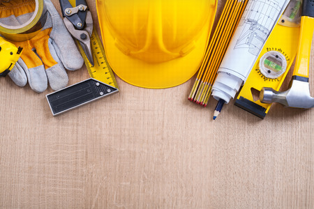 building maintenance: Variety of building objects on oak wooden board construction con