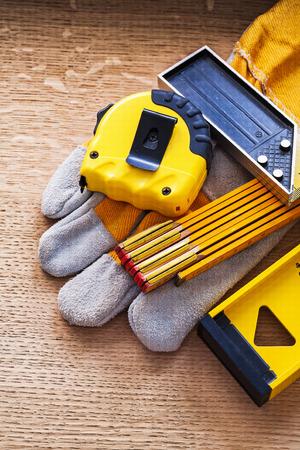oaken: Units of measurement and protective glove on oaken board constru Stock Photo
