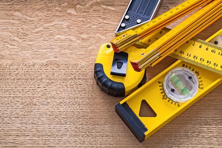 oaken: Wood oaken board with yellow objects of measurement construction