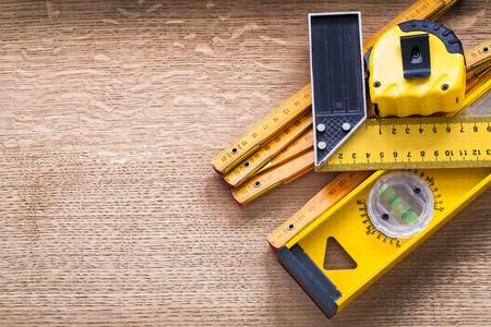 oaken: Working tools of measurement on oaken wooden board construction