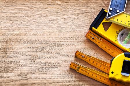 oaken: Working tools of measurement on oaken wooden board maintenance c