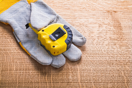 protective work wear: yellow construction tape measure obverse on side of the protecti