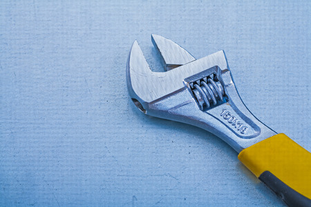 adjustable spanner: Adjustable spanner on metallic background construction concept Stock Photo