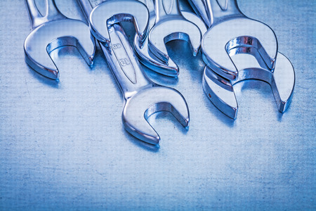 close up  wrench: Close up view of stainless spanner wrenches on metallic backgrou
