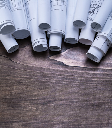 piny: Collection of blueprint rolls on pine wooden vintage board