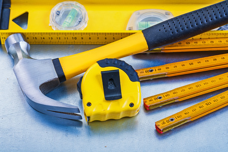 tape line: Construction level tape line claw hammer wooden meter on metallic