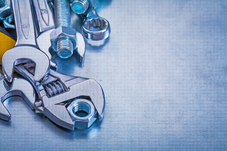 close up  wrench: Group of stainless construction objects on metallic background  Stock Photo
